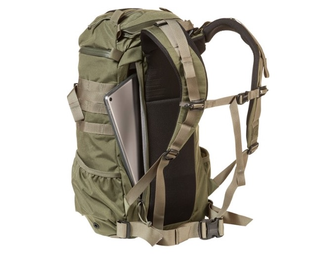 The Mystery Ranch 2 Day Assault Pack shown here in a green color from the back to show the straps and yoke system as well as the the laptop pocket.