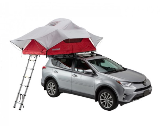 The Yakima SkyRise roof top tent on top of a vehicle on a white background.