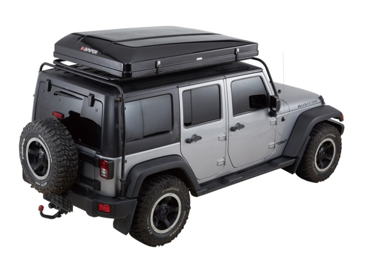 the ikamper roof top tent shown packed up in the hardshell cover and stowed on top of a vehicle