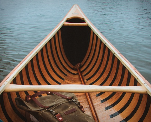 This image shows the Sanborn Prospector Canoe inside which highlights the construction and materials on the interior of the canoe.